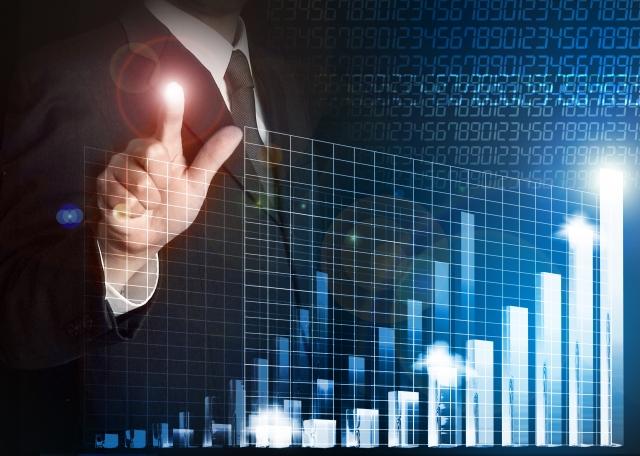 営業マンと上昇する棒グラフ